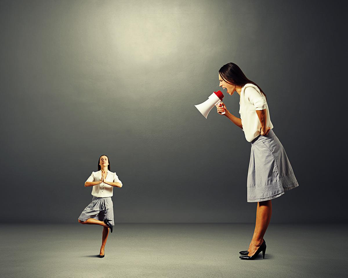 woman screaming at small yoga woman